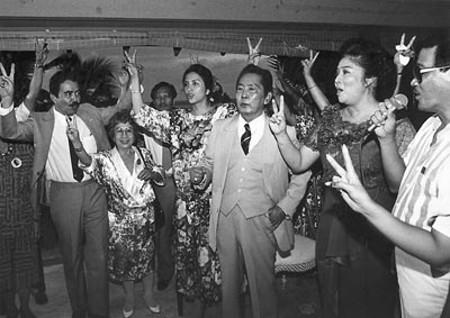 President Marcos and group sing 'Ako ay Filipino'