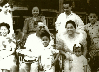 A rare photograph of the Laurel family taken at Malacañang.  President Jose Laurel holding the young Salavdor