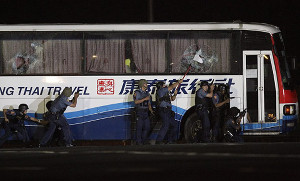 An armed man held hostage a busload of Hongkong tourists in Manila