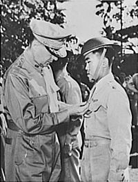 General Douglas MacArthur (left) is shown pinning a Distinguished Service Cross on Captain Jesús A. Villamor of the Philippine Army Air Corps, for 